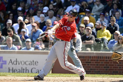 Adam LaRoche drives a ball that was caught by Chicago Cubs left fielder Alfonso Soriano
