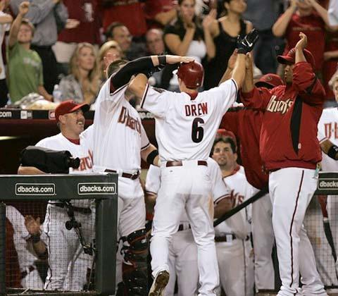 Arizona's Stephen Drew celebrates after his solo homer puts the Diamondbacks.