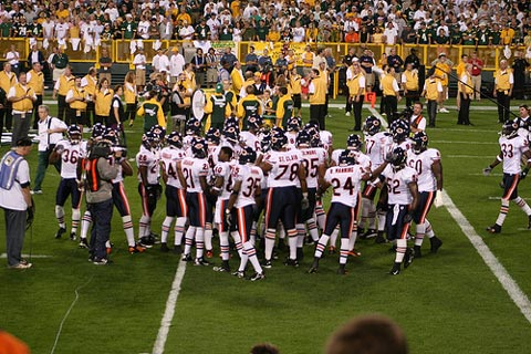 Chicago Bears huddle.