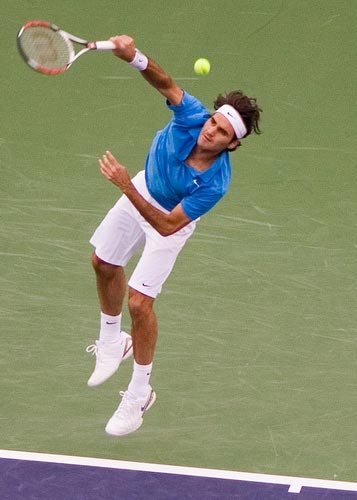 Roger throws his body into his serve.