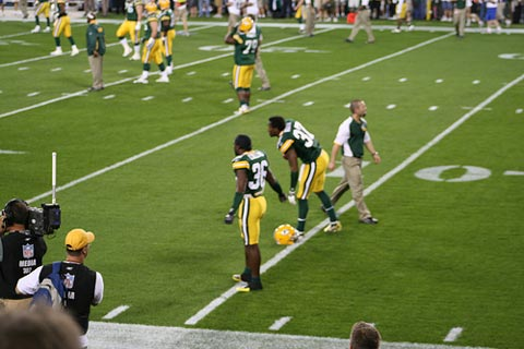 Green Bay secondary stretching before the game.