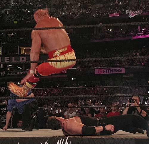 Hulk Hogan hitting his infamous Leg Drop.