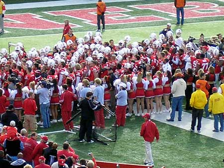 Huskers win and sing in the southeast corner of Tom Osborne Field.