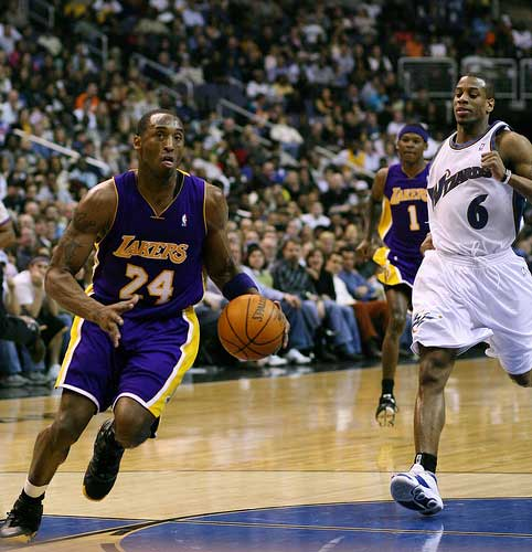 Kobe Bryant of the Los Angeles Lakers drives to the basket.