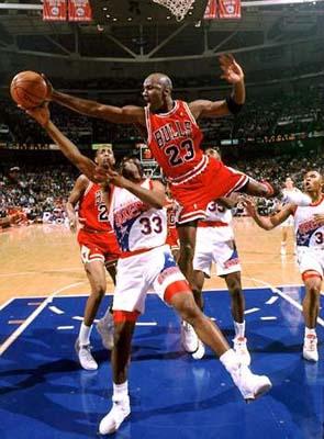 Michael Jordan blocks Hersey Hawkins.