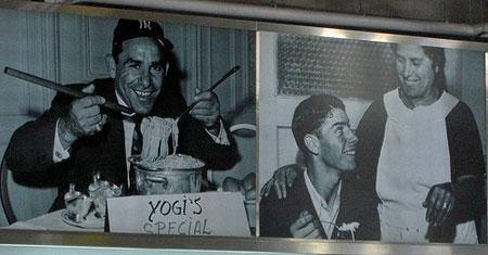 Yankee Hall of Famers Yogi Berra and Joe Dimaggio in the yankee Stadium food court.